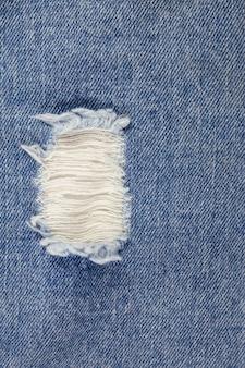 Vecchio sfondo di jeans blu