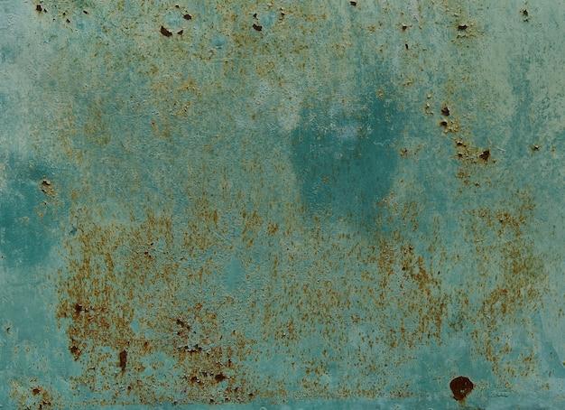 Vecchio muro dipinto di blu con texture ruggine. fondo del metallo arrugginito di lerciume. macchie di ruggine