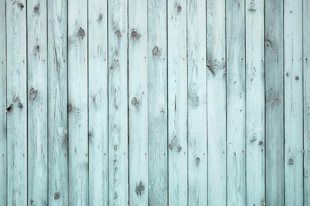 Vecchio recinto di legno blu. texture stagionata con vernice scrostata.