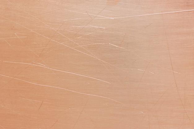 Vecchio fondo in ottone o rame, trama di una piastra metallica arancione vintage