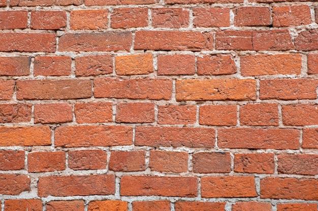 Vecchio muro di mattoni marable. muratura da una vecchia pietra marabile in stile rustico. la struttura e il modello del muro di pietra distrutto. copia spazio.