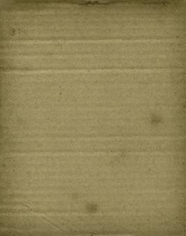 Vecchia carta da parati di superficie di struttura del cartone ondulato marrone