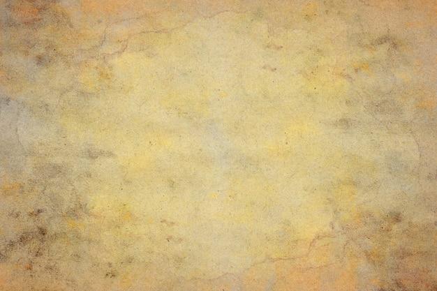 Vecchia priorità bassa del grunge di carta marrone. struttura astratta di colore del caffè liquido.