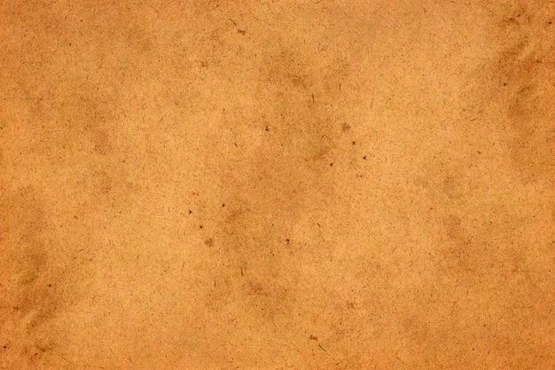 Vecchio fondo di lerciume della carta marrone. struttura liquida astratta di colore del caffè.