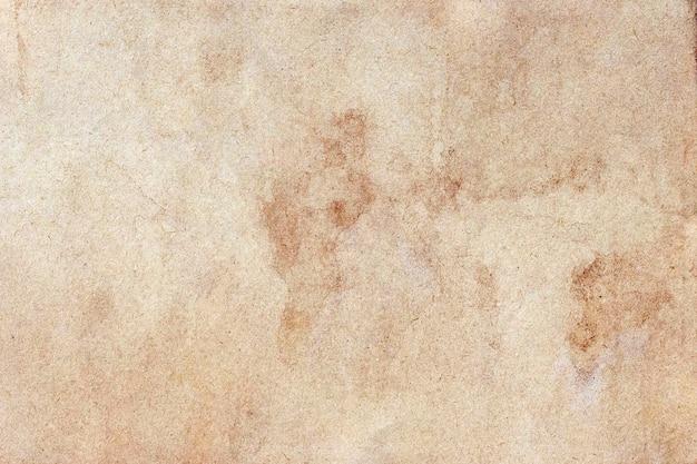 Vecchia superficie del grunge di carta marrone. struttura astratta di colore del caffè liquido.