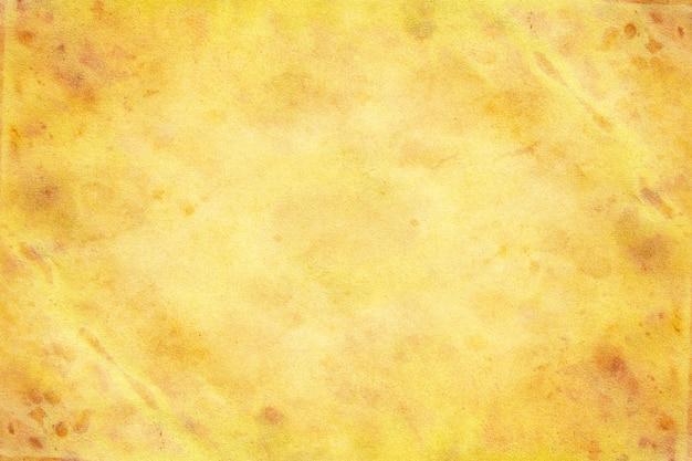 Vecchia priorità bassa del grunge di carta gialla marrone.