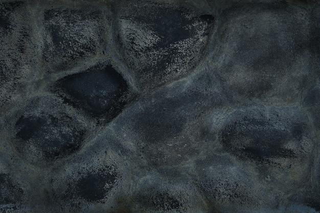 Vecchia struttura di pietra nera della costruzione