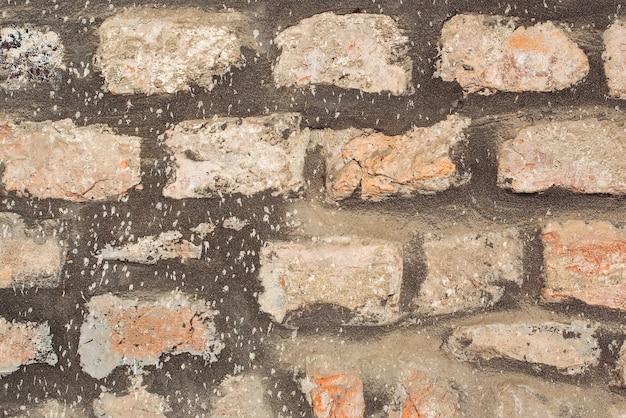 Vecchio fondo di struttura del muro di pietra del castello