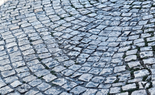 Vecchio primo piano della pavimentazione di ciottoli. texture per pavimentazione in pietra. fondo strutturato astratto.