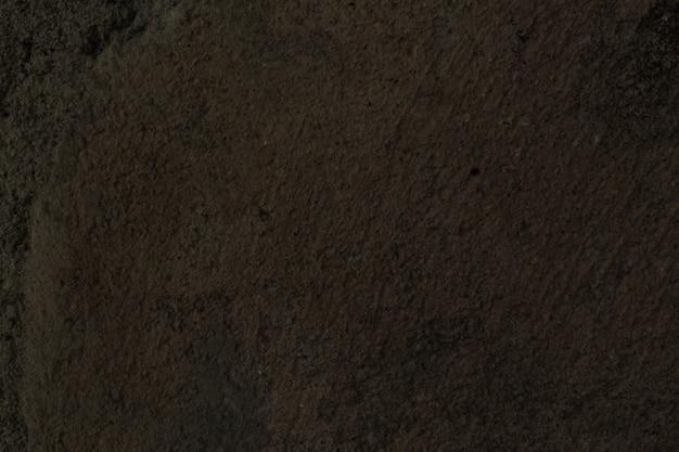 Vecchio muro di cemento in colore bianco e nero e marrone
