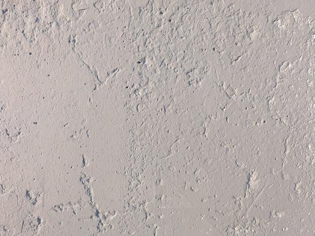 Il vecchio muro di cemento è grigio. trama di pietra per il design. foto di alta qualità