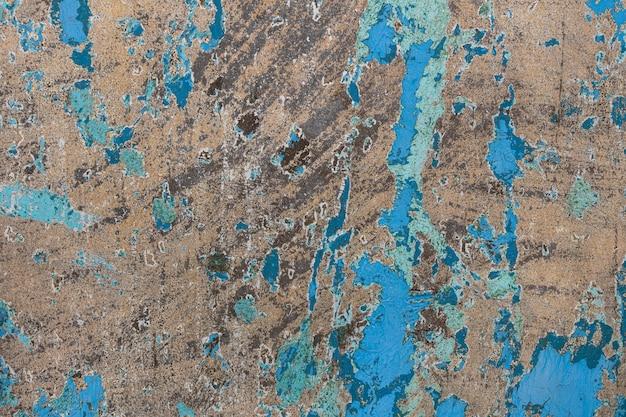 Vecchio muro di cemento con vernice sbiadita. foto di alta qualità
