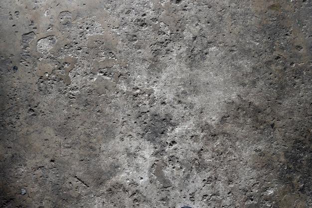 Vecchio fondo di cemento incrinato del pavimento. vista dall'alto