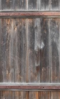 Vecchio fondo scuro della porta di legno strutturato, superficie di vecchia struttura di legno marrone, vista dall'alto, spazio della copia