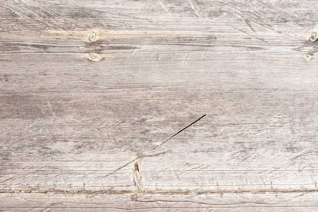 Vecchia superficie di sfondo in legno scuro con motivo naturale