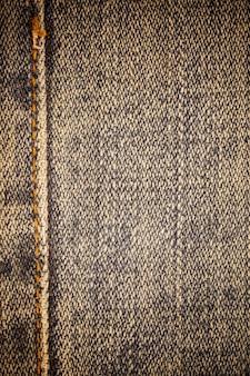 Vecchio fondo sporco di struttura delle blue jeans.