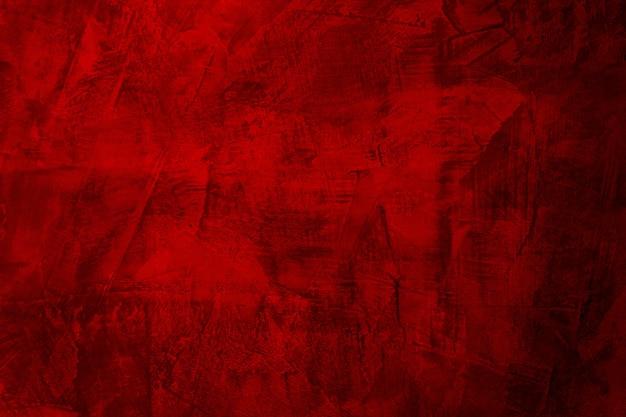 Vecchio materiale rosso sporco del cemento o del calcestruzzo nella struttura astratta della parete.