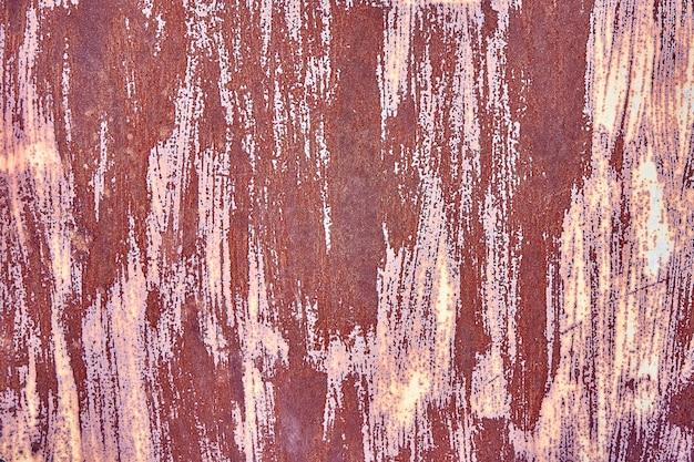 Old rusty brown terracotta copper rusty spazio con texture ruvida inclusioni multicolori. superficie granulosa grossolana a gradiente macchiato. sfondo