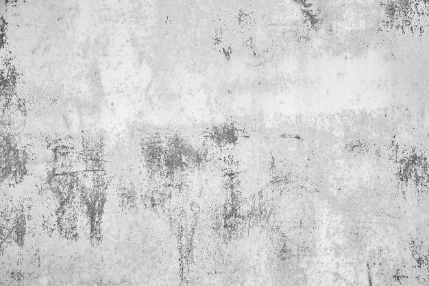 Vecchio sfondo di cemento afflitto con inclusioni di texture ruvida.