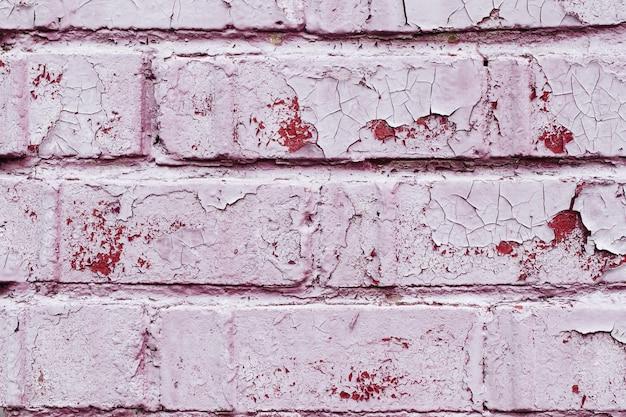Vecchio muro di mattoni polveroso con la struttura della pittura della sbucciatura