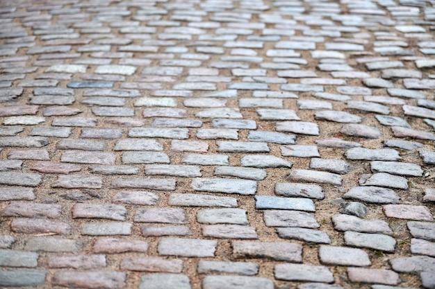 Vecchia struttura tedesca delle pietre della pavimentazione.