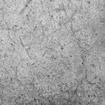 Vecchio muro di cemento grigio per lo sfondo