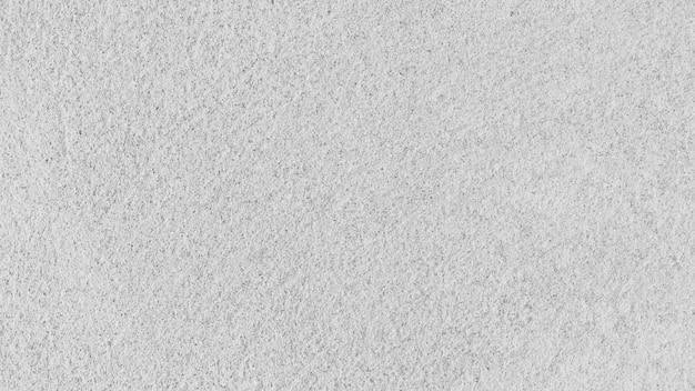 Vecchio muro di cemento bianco di struttura del fondo dell'estratto del grunge