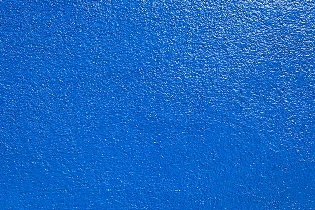 Vecchio fondo di struttura della parete blu navy del grunge.