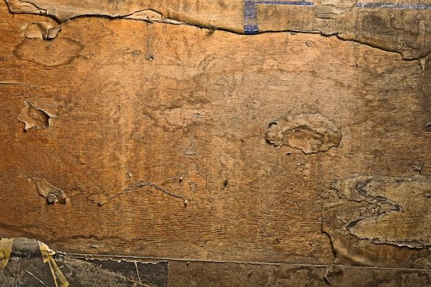 Vecchia carta grunge su legno
