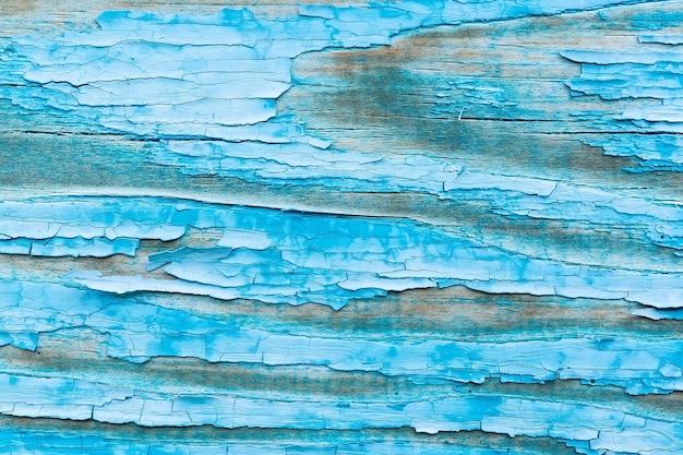 Vecchio reticolo di recinzione in legno grunge in tonalità blu navy.