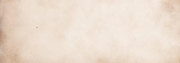Vecchio fondo di carta beige chiaro per design e testo