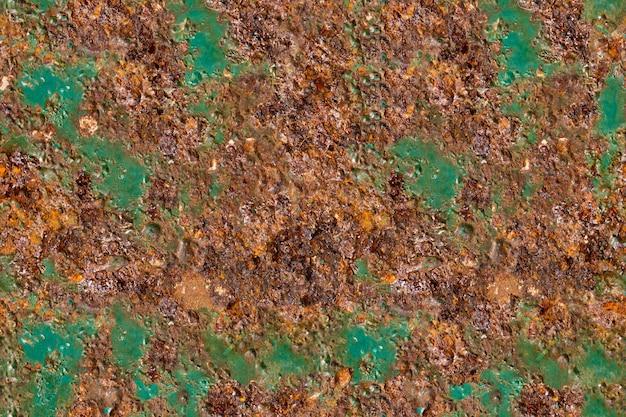 Vecchia placca di metallo con vernice verde e ruggine. trama senza soluzione di continuità. foto di alta qualità