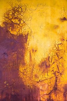 Fondo verticale della vecchia pittura giallo e porpora
