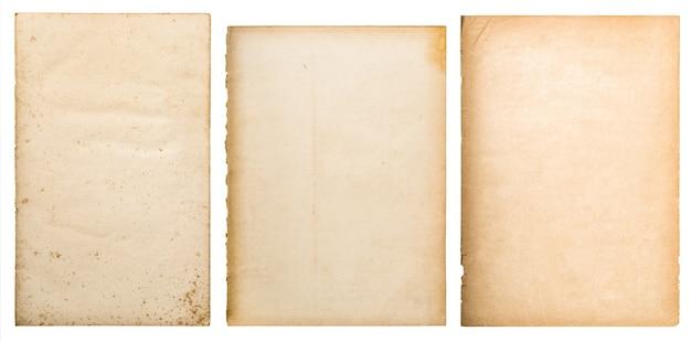Vecchio fondo di struttura di carta. pagina del libro usurata isolata su bianco
