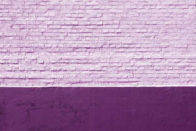 Vecchio fondo viola del muro di mattoni