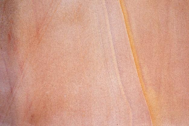 Vecchio fondo di struttura della parete di pietra della sabbia rossa. pavimento in pietra astratta