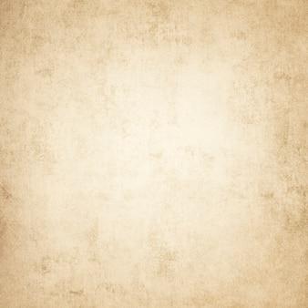 La vecchia trama ruvida della carta in macchie e striature per il design