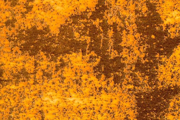 Vecchia ruggine sulla parete di metallo