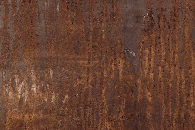 Vecchio pannello di parete di metallo arrugginito, struttura della ruggine del ferro per fondo