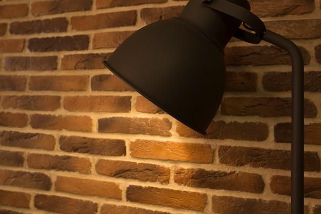 Lampada da tavolo vecchio stile su uno sfondo di muro di mattoni. primo piano