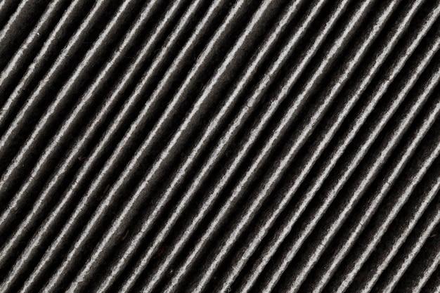 Il vecchio filtro usato completamente sporco è nero, il filtro di purificazione dell'aria è completamente sporco