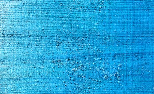 Vecchie plance di legno verniciate blu e beige dell'annata. trama di sfondo rustico con graffi.