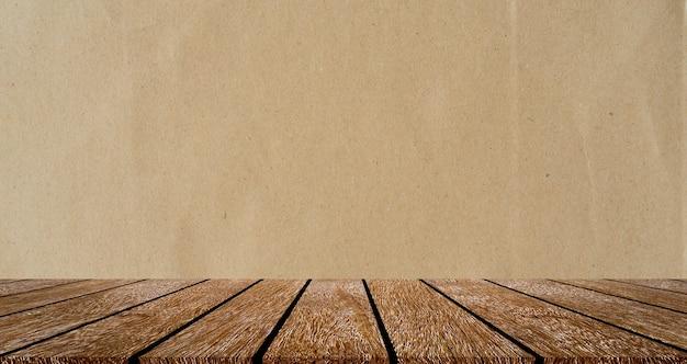 Vecchio ripiano del tavolo con pannello in legno marrone vintage con trama di carta semplice sfondo color seppia per lo spettacolo