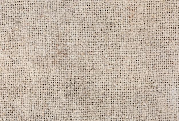 Vecchio tessuto vintage in tessuto di lino. fondo rustico di struttura della tela da imballaggio.