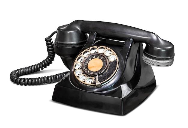 Vecchio telefono vintage isolato su bianco con tracciato di ritaglio