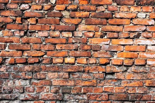 Un vecchio muro di mattoni rossi. sfondo per il design. foto di alta qualità