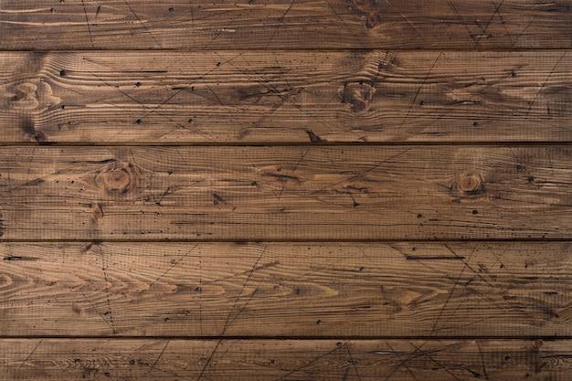 Vecchia struttura di legno marrone stagionata delle plance
