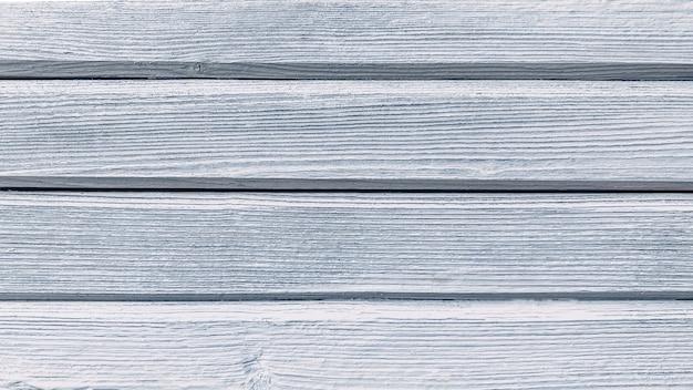 Vecchio fondo di legno bianco blu dei bordi orizzontali dipinti colorati nello spazio della copia di stile di lerciume