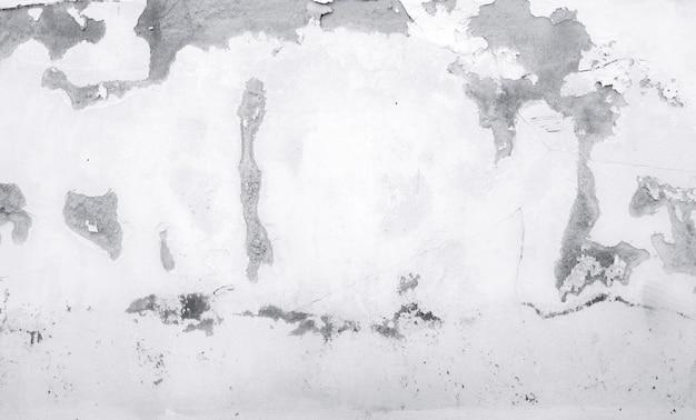 Vecchio muro di cemento bianco sono peeling fondo dipinto di struttura astratta del muro di cemento