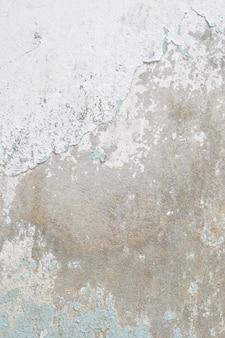 Vecchio fondo di struttura del muro di cemento della vernice bianca